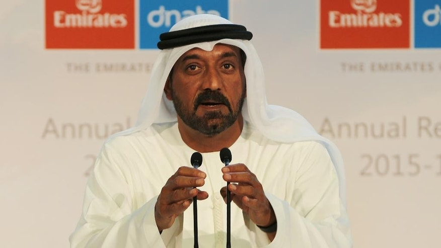 Sheikh Ahmed bin Saeed Al Maktoum, president of the UAE Department of Civil Aviation, CEO and chairman of The Emirates Group and Chairman of Dubai World talks to the journalists at the Emirates Airline annual results news conference in Dubai, United Arab Emirates, Tuesday, May 10, 2016. The Middle East's biggest airline, Emirates, said Tuesday its profits were up by about 56 percent to $1.9 billion in the last fiscal year largely due to lower oil prices that drove down fuel operating costs. (AP Photo/Kamran Jebreili)