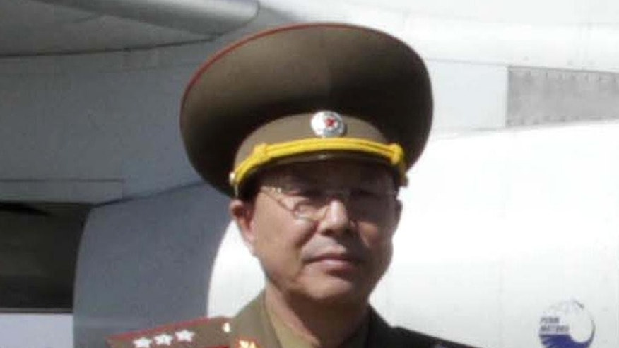 FILE - In this May 22, 2013, file photo, Ri Yong Gil, then North Korean military chief, poses for a photo before leaving Pyongyang Airport, North Korea, for China. Ri who Seoul had said was executed is actually alive and in possession of several new senior-level jobs, the North's state media said Tuesday, May 10, 2016. The news on Ri marks yet another blunder for South Korean intelligence officials, who have often gotten information wrong in tracking developments with their rival. It also points to the difficulties that even professional spies have in figuring out what's going on in one of the world's most closed governments. (AP Photo/Kim Kwang Hyon, File)