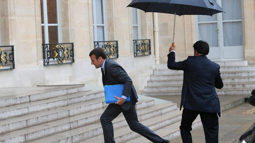 French Economy Minister Emmanuel Macron  arrives for a brief emergency cabinet meeting at the Elysee Palace, in Paris, Tuesday, May 10, 2016. The French government has decided to use special power to pass a hotly contested labor reform without vote at lower house of parliament. (AP Photo/Christophe Ena)