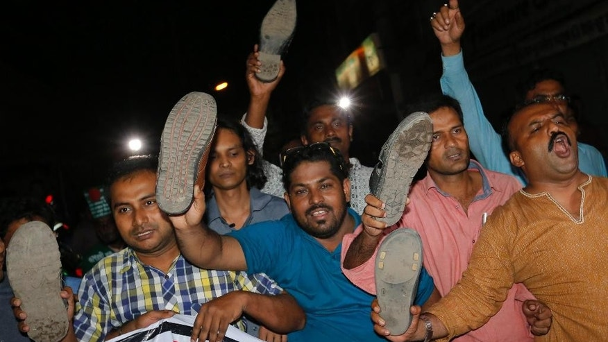 Bangladeshi activists show shoes, as they celebrate outside Dhaka's central jail, after the execution of the Jamaat-e-Islami party's chief Motiur Rahman Nizami in Dhaka, Bangladesh, early Wednesday, May 11, 2016. Nizami is the fifth senior official from opposition parties to be executed since 2013 for war crimes carried out during the 1971 war. Three other senior members of Nizami's Jamaat-e-Islami party and a top leader of the main opposition Bangladesh Nationalist Party led by former Prime Minister Khaleda Zia were also hanged. (AP Photo)