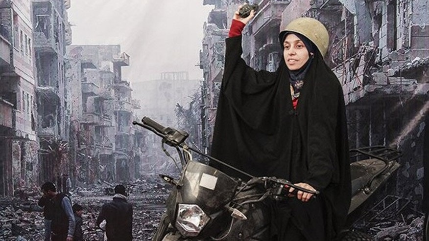 An Iranian woman poses in front of a war scene from Syria.