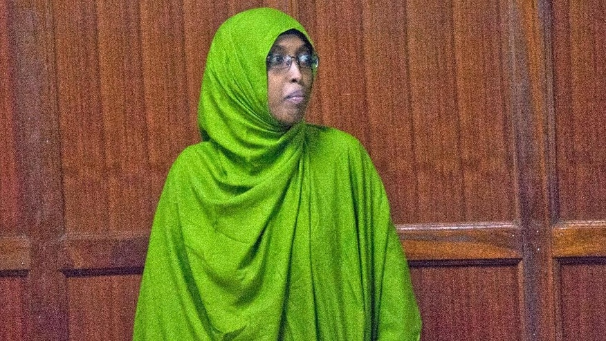 Nuseiba Mohammed Haji stands in the dock at the Kenya Milimani Law Courts, in Nairobi, Tuesday May 10, 2016. The wife of a Kenyan medic police accuse of plotting a biological attack has been extradited to Kenya from Uganda. Police allege Nuseiba Mohammed Haji, a medical student in Uganda and wife to medical intern Mohammed Ali Abdi, is an accomplice in a foiled plan to launch an anthrax attack in Kenya late April, by a cell of extremist medics. (AP Photo/Sayyid Abdul Azim)