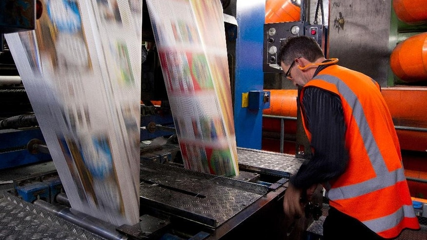 In this Sept. 9, 2012 photo, the first edition of the new compact New Zealand Herald rolls off the press in Auckland, New Zealand. Facing declining revenues and changing reader habits, New Zealand's two main newspaper groups, Fairfax Media and APN News & Media, announced Wednesday, May 11, 2016, they're discussing a merger that could end decades of competition and result in hundreds of job losses. (Sarah Ivey/New Zealand Herald via AP) NEW ZEALAND OUT, AUSTRALIA OUT