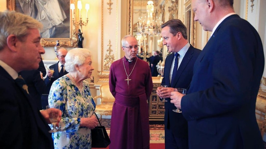 Britain's Queen Elizabeth, second left, speaks with Prime Minister David Cameron, second right, as leader of the House of Commons Chris Grayling, right, and Archbishop of Canterbury Justin Welby, center, watch during a reception in Buckingham Palace to mark the The Queen's 90th birthday, in London, Tuesday, May 10, 2016. (Paul Hackett/Pool Photo via AP)