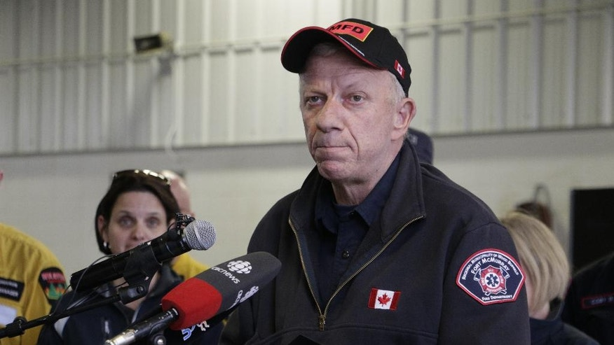 Fort McMurray, Alberta, fire chief Darby Allen speaks to members of the media at a fire station in Fort McMurray, Monday, May 9, 2016. A break in the weather has officials optimistic they have reached a turning point on getting a handle on the massive wildfire. (AP Photo/Rachel La Corte)