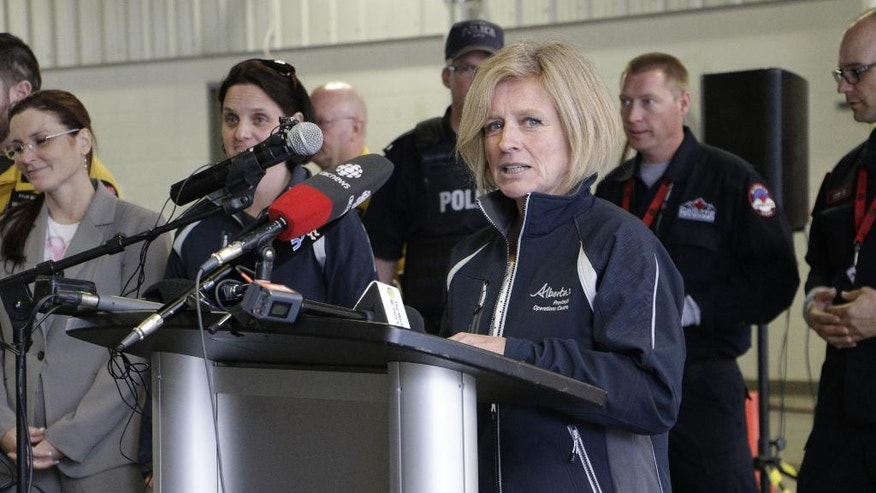 Alberta Premier Rachel Notley speaks to members of the media at a fire station in Fort McMurray, Alberta, Monday, May 9, 2016. A break in the weather has officials optimistic they have reached a turning point on getting a handle on the massive wildfire. (AP Photo/Rachel La Corte)