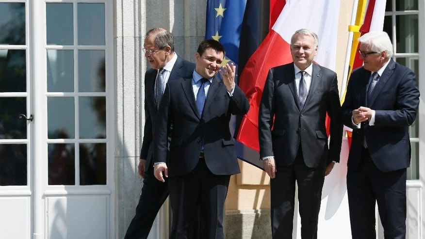 From left Sergei Lavrov, Foreign Minister of Russia, Pavlo Klimkin, Foreign Minister of Ukraine, Jean-Marc Ayrault, Foreign Minister of France and Frank-Walter Steinmeier, Foreign Minister of Germany arrive for a photo prior to talks at the German foreign ministry's guest house Villa Borsig in Berlin, Germany, Wednesday, May 11, 2016. (Hannibal Hanschke/Pool Photo via AP)