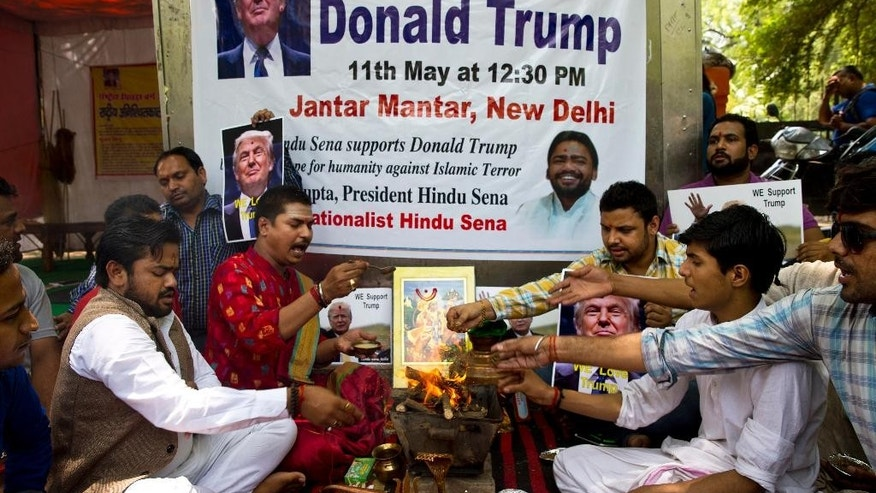 Activists of right-wing Hindu Sena or Hindu Army conduct Hindu rituals to ensure a win for U.S. presidential candidate Donald Trump in New Delhi, India, Wednesday, May 11, 2016. While Trump has dominated the Republican primary race to decide the party's candidate for the November election, his calls for temporarily banning Muslims from America and cracking down on terrorist groups abroad have earned him some fans in faraway India. (AP Photo/Saurabh Das)
