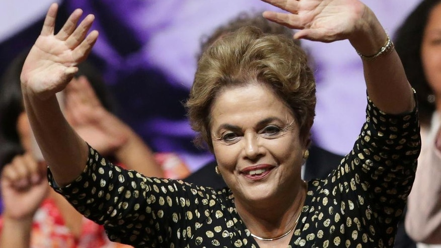 Brazil's President Dilma Rousseff waves to the crowd during the opening of the National Conference of Women, in Brasilia, Brazil, Tuesday, May 10, 2016. The impeachment proceedings against Rousseff took another hairpin turn Tuesday after the acting speaker of Congress' lower house Waldir Maranhao put the impeachment process back on track a day after he sparked chaos and sowed further discord among Brazil's fractious political class by annulling an April 17 vote by the Chamber of Deputies for impeachment. (AP Photo/Eraldo Peres)