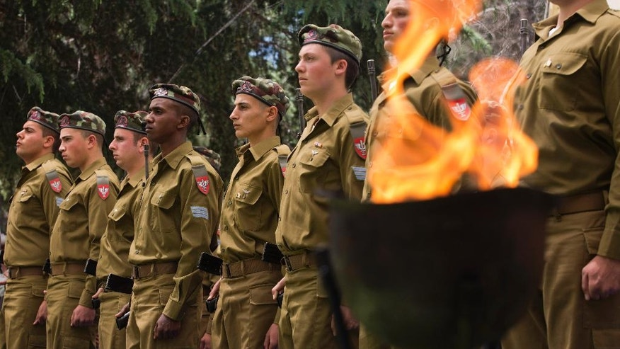 Israeli soldiers stand in formation during an official state Memorial Day service for the country's fallen soldiers and victims of terrorism during a ceremony held on Mount Herzl Cemetery on Wednesday, May 11, 2016. (Heidi Levine/Pool Photo via AP)