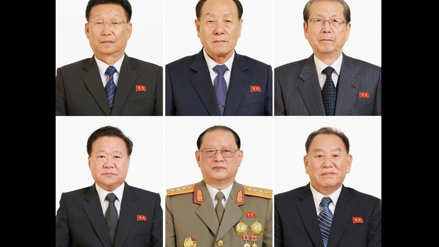Elected members and candidates of the Politburo of the North Korean Workers' Party pose for a photo at the Workers' Party congress.