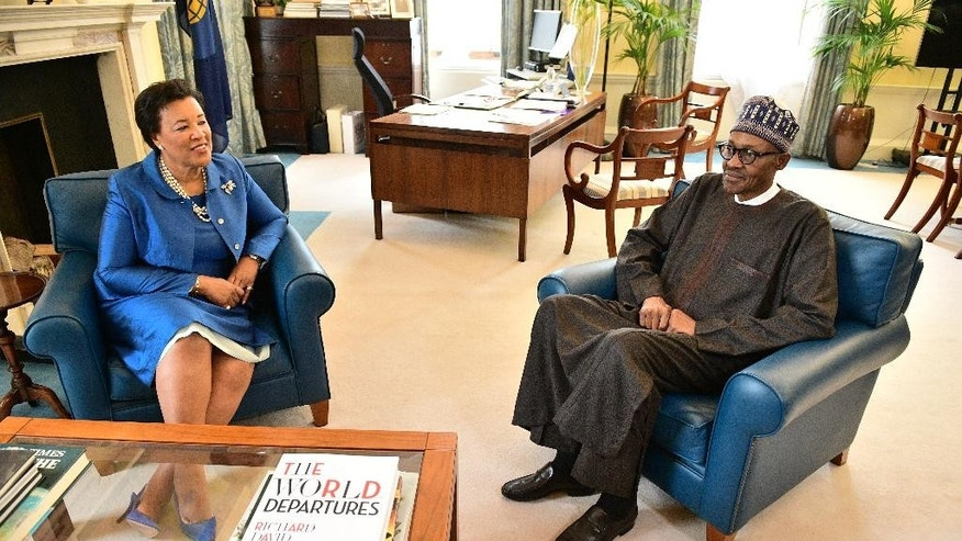 Patricia Scotland, Secretary General of the Commonwealth meets Nigerian President Muhammadu Buhari at Marlborough House in London on Wednesday May 11, 2016 prior to the start of a conference to tackle corruption .  Buhari says he won't demand an apology after British Prime Minister David Cameron called his country one of the world's most corrupt nations. (Leon Neal, Pool via AP)