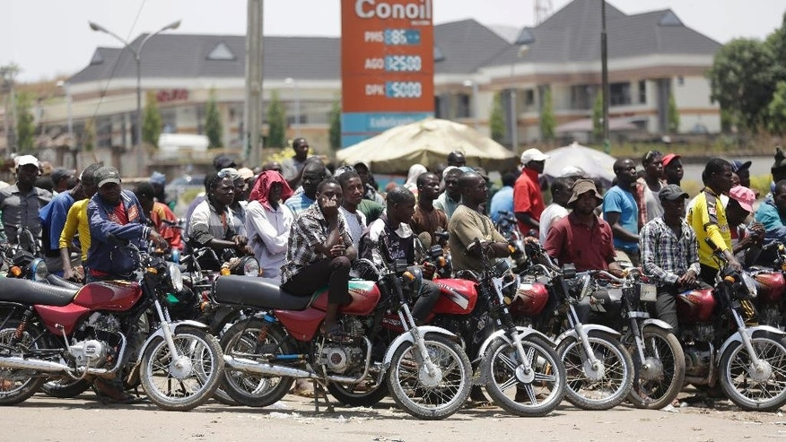 In this photo taken Sunday April 10, 2016, motorcycles wait for fuel at the petrol station in Abuja, Nigeria. Nigeria's government announced Wednesday May 11, 2016 it is lifting a controversial subsidy on gas, nearly doubling the price amid a massive fuel shortage and militant attacks on oil installations in Africa's biggest petroleum producer. (AP Photo/Sunday Alamba)
