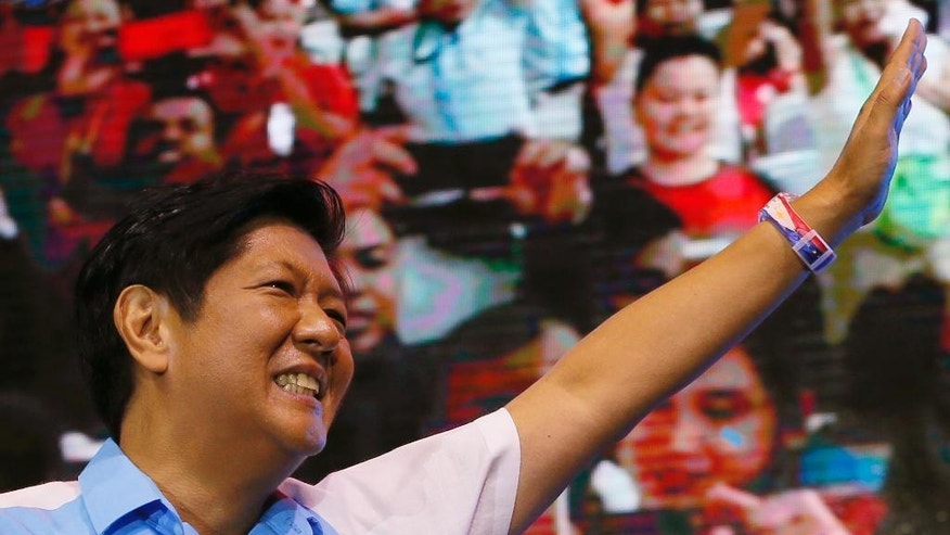 "FILE - In this Thursday, May 5, 2016, file photo, vice presidential candidate Sen. Ferdinand ""Bongbong"" Marcos Jr., waves to supporters on his last campaign rally for the presidential elections in suburban Mandaluyong city, east of Manila, Philippines. The son of the late Philippine dictator Ferdinand Marcos asked for a stop to an unofficial vote count that shows his rival has overtaken him. Marcos' adviser Rep. Jonathan dela Cruz said Tuesday, May 10, 2016, the campaign had sent an urgent request to the election commission to halt a tally released by an accredited citizens' group, saying the numbers showed ""an alarming and suspicious trend"" that was contrary to independent exit polls. (AP Photo/Bullit Marquez, File)"