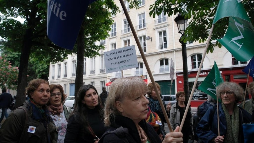 Feminist groups gather during a protest to demand an end to widespread sexism in French politics, next to the National Assembly in Paris, Wednesday, May 11, 2016. Two French government ministers and a top legislator stand accused of sexually harassing or abusing women _ allegedly grabbing breasts, tweaking thong underwear or other inappropriate behavior in the workplace. (AP Photo/Christophe Ena)