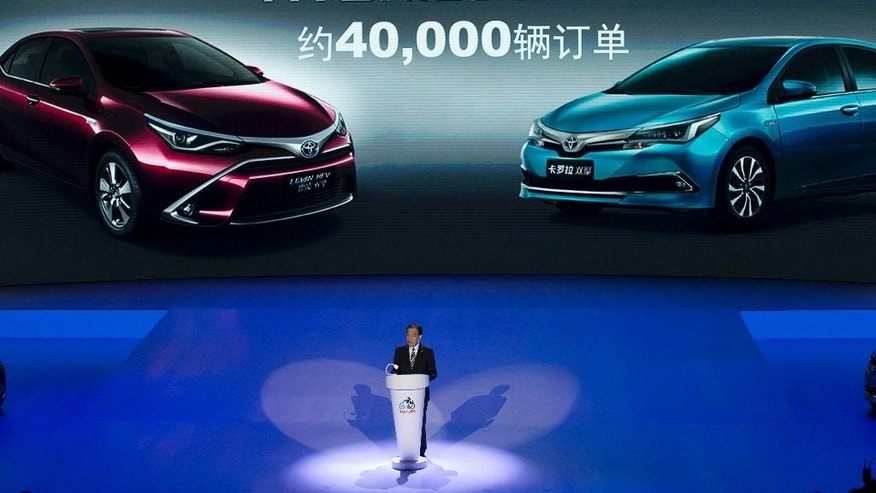 FILE - In this April 24, 2016 file photo, Hiroji Onishi, head of Toyota Motor Co.'s China region operation, speaks during a press conference ahead of the Auto China 2016 automobile exhibition in Beijing, China. Toyota is projecting a 35 percent plunge in profit for the fiscal year through March 2017, as the perks of a favorable exchange rate fade, and it reported a 4 percent drop in profit for January-March on-year at 426.6 billion yen ($3.9 billion). (AP Photo/Ng Han Guan, File)
