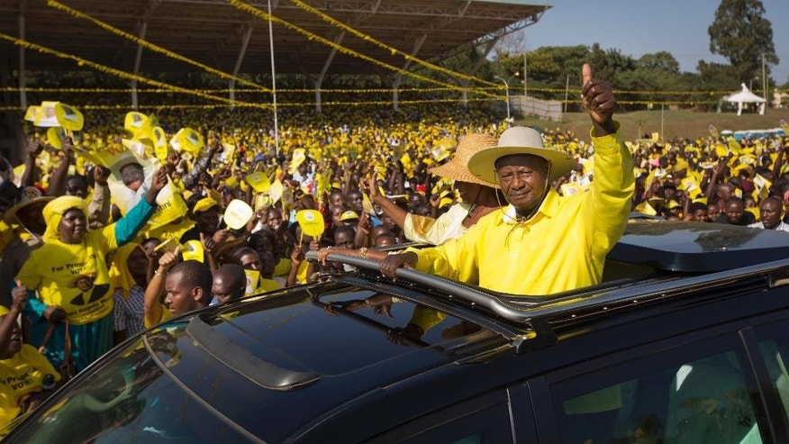 FILE - In this Tuesday, Feb. 16, 2016 file photo, Uganda's long-time President Yoweri Museveni waves to supporters from the sunroof of his vehicle as he arrives for an election rally at Kololo Airstrip in Kampala, Uganda. Uganda's main opposition leader Kizza Besigye was arrested Wednesday, May 11, 2016 ahead of the inauguration Thursday of Museveni, while access to social media sites like Facebook and Twitter appeared to have been blocked by a government censor. (AP Photo/Ben Curtis, File)
