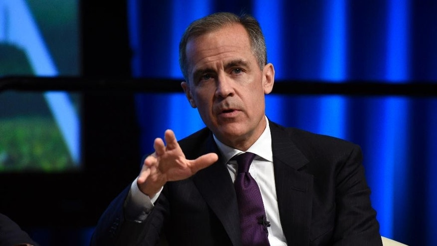 FILE - In this Thursday, April 14, 2016 file photo, Bank of England Governor Mark Carney speaks during the World Bank/IMF Spring Meetings at the World Bank in Washington. The Bank of England has voted to keep interest rates steady amid signs that the economy is beginning to falter and uncertainty over next month's vote on whether Britain should leave the European Union. The bank's nine policymakers unanimously agreed to leave the key interest rate at 0.5 percent. Governor Mark Carney will be questioned about the economic risks of leaving the EU at a news conference at which he will present new growth forecasts for the country. (AP Photo/Sait Serkan Gurbuz, file)