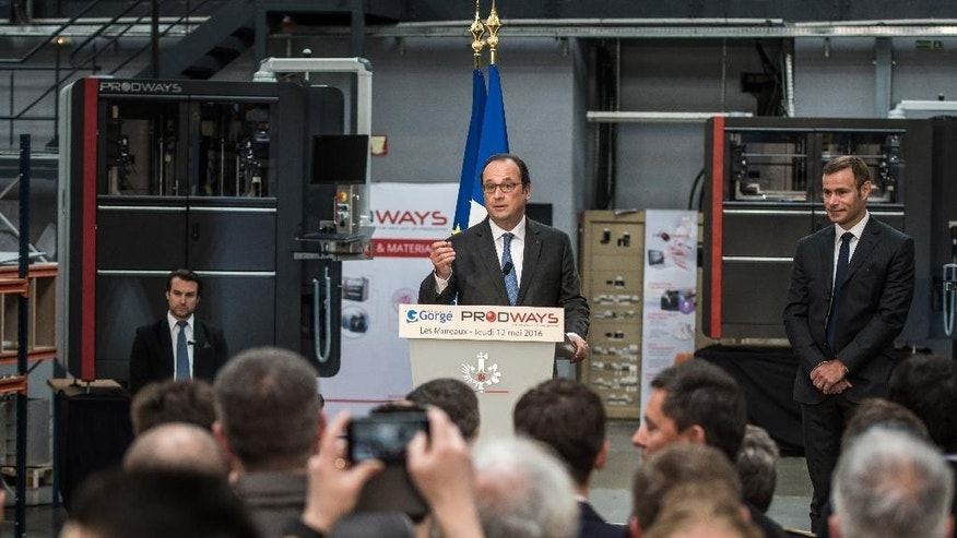 French President Francois Hollande delivers a speech after his visit at Prodways company headquarters in Les Mureaux, outside Paris, France, Thursday, April 12, 2016. Prodways is a design and engineering company  dedicated to 3D printers technology. France's government is facing a major test as lawmakers hold a no-confidence vote, prompted by a deeply divisive labor law allowing longer workdays and easier layoffs.(Christophe Petit-Tesson/Pool Photo via AP)