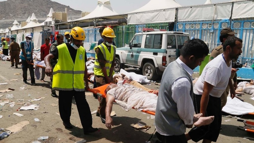 FILE - In this Thursday, Sept. 24, 2015 file photo, emergency services personnel attend to victims of a stampede in Mina, Saudi Arabia during the annual hajj pilgrimage. Iran will not send pilgrims to Saudi Arabia this year for the annual hajj pilgrimage, an Iranian official announced Thursday, May 12, 2016 the latest sign of tensions between the two Mideast powers after a disaster during the event last year killed at least 2,426 people. (AP Photo, File)