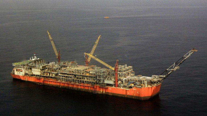 FILE - In this Monday, Dec. 26, 2011 file photo, Shell Bonga offshore oil Floating Production Storage and Offloading vessel off the coast of the Niger Delta in Nigeria. Shell closed the terminal exporting Nigeria's benchmark Bonny Light crude oil on Wednesday May 11, 2016 and was evacuating workers from a threatened oil field as renewed militant attacks cut production in Africa's biggest petroleum producer, the company and a union leader said. (AP Photo/Sunday Alamba, file)