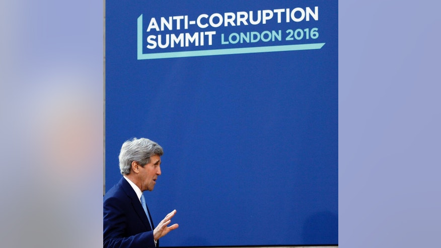 US Secretary of State John Kerry arrives for the Anti-Corruption Summit in London, Thursday, May 12, 2016. (AP Photo/Frank Augstein)