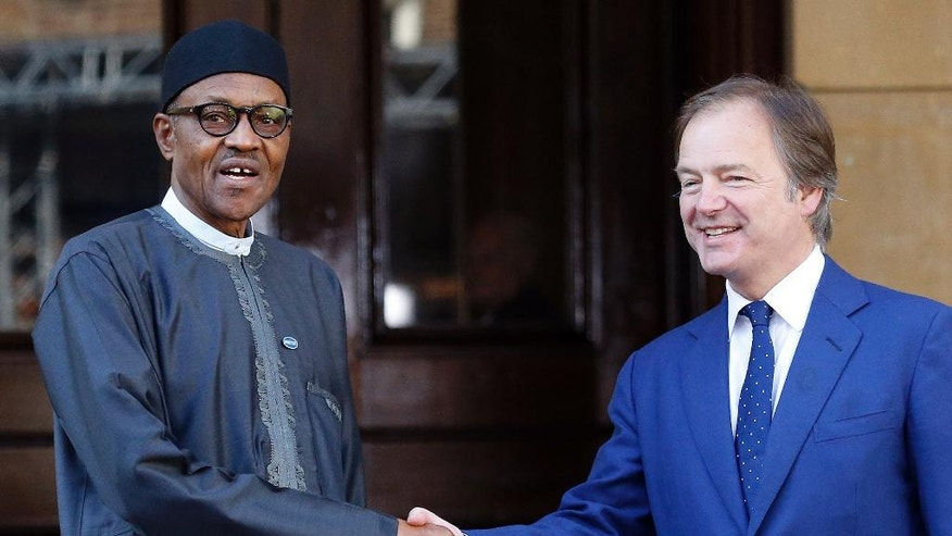 Nigeria President Muhammadu Buhari is welcomed by Minister of State for the Foreign and Commonwealth Office, Hugo Swire as he arrives for the Anti-Corruption Summit in London, Thursday, May 12, 2016. (AP Photo/Frank Augstein)