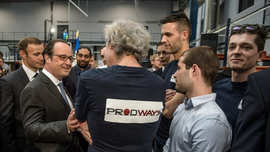 French President Francois Hollande, left, speaks with Prodways employees during a visit at  Prodways company headquarters in Les Mureaux, outside Paris, France, Thursday, April 12, 2016. Prodways is a design and engineering company  dedicated to 3D printers technology. France's government is facing a major test as lawmakers hold a no-confidence vote, prompted by a deeply divisive labor law allowing longer workdays and easier layoffs.(Christophe Petit-Tesson/Pool Photo via AP)
