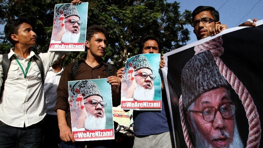 Supporters of Pakistani religious party Jamaat-e-Islami condemn the execution of the party's chief Motiur Motiur Rahman Nizami, in Bangladesh, in Karachi, Pakistan, Wednesday, May 11, 2016 . The head of Bangladesh's largest Islamist party was executed early Wednesday for his role in acts of genocide and war crimes during the country's independence war against Pakistan in 1971, a senior government official said. (AP Photo/Fareed Khan)
