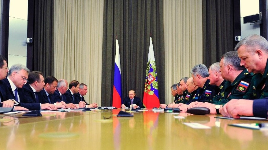 Russian President Vladimir Putin, center, chairs a meeting with military and defense industries' officials in the Bocharov Ruchei residence in Sochi, Russia, Thursday, May 12, 2016. The meeting focused on production goals for defense industries. (Mikhail Klimentyev/Sputnik, Kremlin Pool Photo via AP)