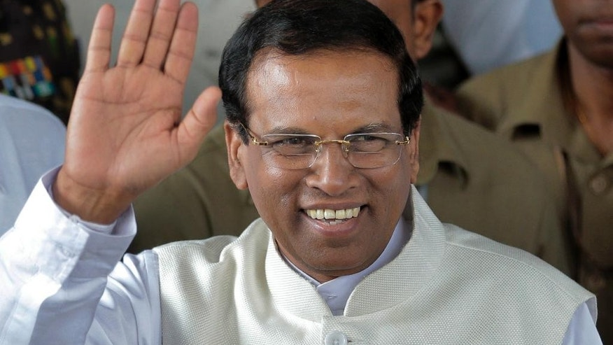 FILE - In this Jan. 9, 2015 file photo, Sri Lanka's then-incoming President Maithripala Sirisena waves to supporters as he leaves the election secretariat in Colombo, Sri Lanka. Sri Lanka's leader was to visit neighboring India on Friday, May 13, 2016 for a second state visit in 17 months, underscoring his island nation's delicate efforts to balance relations with regional superpowers India and China.  (AP Photo/Eranga Jayawardena, File)