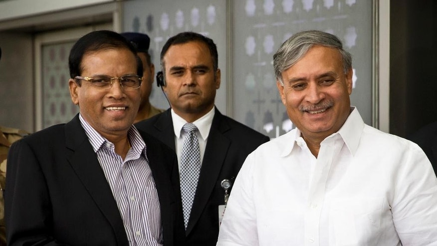 Sri Lankan President Maithripala Sirsena, left, is received by Indian minister of state Rao Inderjit Singh, as he arrives in New Delhi, India, Friday, May 13, 2016. Sri Lanka's leader arrived in India on Friday for a second state visit in 17 months, underscoring his island nation's delicate efforts to balance relations with regional superpowers India and China. (AP Photo/Saurabh Das)