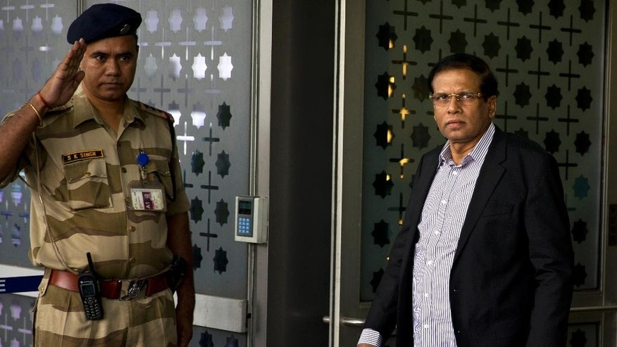 Sri Lankan President Maithripala Sirsena arrives in New Delhi, India, Friday, May 13, 2016. Sri Lanka's leader arrived in India on Friday for a second state visit in 17 months, underscoring his island nation's delicate efforts to balance relations with regional superpowers India and China. (AP Photo/Saurabh Das)