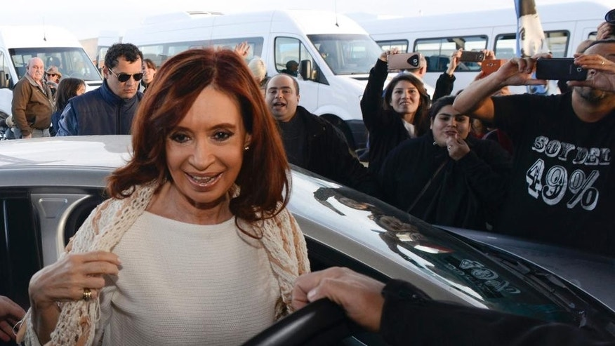 FILE - In this April 11, 2016 file photo, Argentina's former President Cristina Fernandez arrives at the airport in El Calafate, Argentina, as she travels to the capital to face questions about her government's handling of the futures dollar market. A judge in Argentina is charging Fernandez with defrauding the State as part of her government's handling of the futures dollar market. Federal judge Claudio Bonadio said Friday, May 13, 2016 that a scheme to keep the Argentine peso inflated by selling derivatives below market value would not have been possible without Fernandez's approval.  The crime is punished with 5 to20 years in prison. (AP Photo/Francisco Munoz, File)