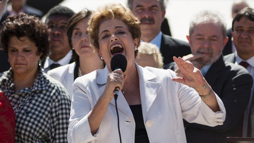 "Brazil's President Dilma Rousseff speaks after leaving Planalto presidential palace in Brasilia, Brazil, Thursday, May 12, 2016. Speaking hours after the Senate voted to impeach her on Thursday, Rousseff blasted the process as ""fraudulent"" and promised to fight what she characterized as an injustice more painful than the torture she endured under a past military dictatorship. (AP Photo/Felipe Dana)"