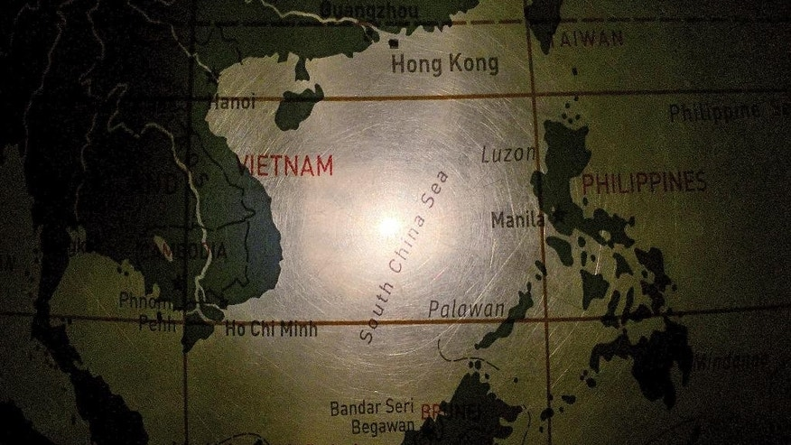 In this May 1, 2016, photo, an illuminated globe shows the South China Sea at a museum in Pathumthani, Thailand. Seeking to calm escalating tensions in the South China Sea, top generals from China and the U.S. spoke by phone and said they were ready to work out an effective mechanism to prevent confrontation and maintain stability in the region. (AP Photo/Charles Dharapak)