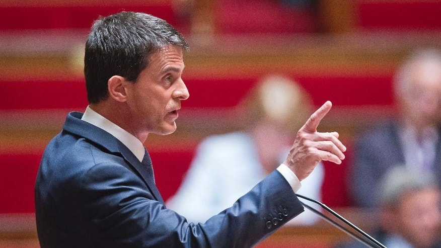 French Prime Minister Manuel Valls delivers a speech during the labor law debate at the national assembly in Paris, France, Thursday, May 12, 2016. France's government is facing a major test as lawmakers hold a no-confidence vote, prompted by a deeply divisive labor law allowing longer workdays and easier layoffs. (AP Photo/Michel Euler)