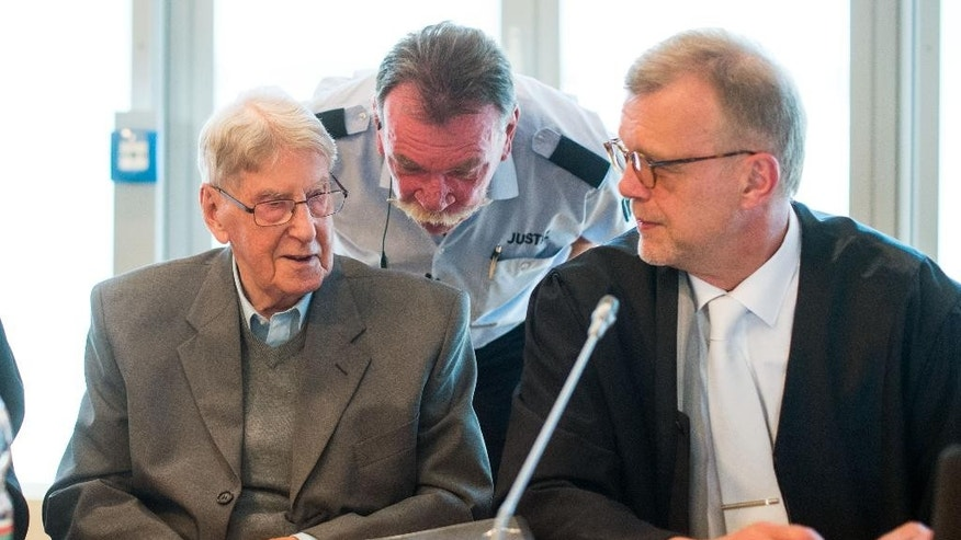94-year-old former SS guard at the Auschwitz death camp Reinhold Hanning, left, sits next to his lawyer Johannes Salmen, right, during his trial in Detmold, Germany, Friday, May 13, 2016. Hanning faces trial for 170,000 counts of accessory to murder, the first of up to four cases being brought to court this year by German  prosecutors to punish Nazi war crimes. (Bernd Thissen/Pool Photo via AP)