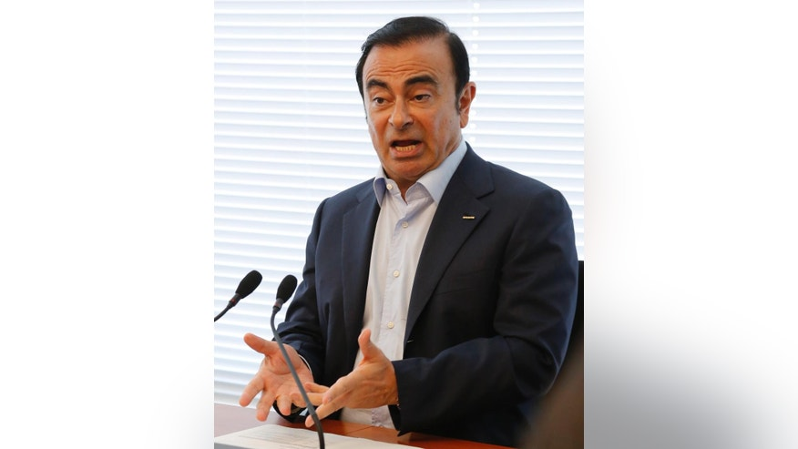 Nissan Chief Executive Carlos Ghosn speaks to the media in the automaker's headquarters in Yokohama, Friday, May 13, 2016. Ghosn is confident the 237 billion yen ($2.2 billion) investment to take a controlling stake in scandal-embroiled Mitsubishi Motors will prove a bargain when sheer size is increasingly critical in the auto industry. (AP Photo/Yuri Kageyama)