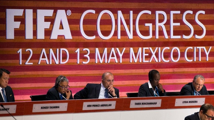 FIFA council members listen during the 66th FIFA Congress, in Mexico City, Friday, May 13, 2016. From left, are Kohzo Tashima of Japan, Prince Abdullah of Malaysia, Tarek Bouchamaoui of Tunisia, Lydia Nsekera of Burundi, and Hany Abo Rida of Egypt. (AP Photo/Rebecca Blackwell)