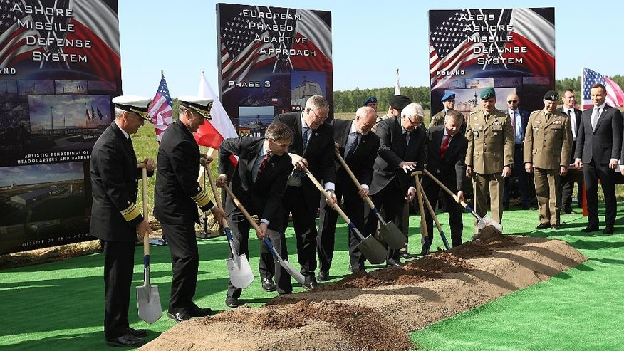 U.S. and Polish officials symbolically break the ground for a construction of the U.S.-led missile defense site that is to be operational in 2018 and defend Europe and the U.S. from missile attacks from outside the Euro-Atlantic area, in Redzikowo, northern Poland, Friday May 13, 2016.  (AP Photo/Michal Fludra)