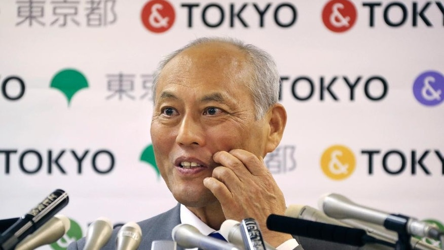 Tokyo Gov. Yoichi Masuzoe answers reporters questions during a press conference in Tokyo, Friday, May 13, 2016. The governor Tokyo has triggered public outrage for flying first-class and staying at up to $1,800-a-night suites in Europe and America during official overseas trips. (AP Photo/Koji Sasahara)