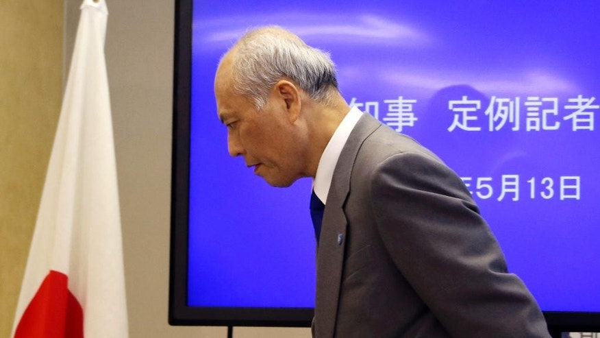 Tokyo Gov. Yoichi Masuzoe leaves after a press conference in Tokyo, Friday, May 13, 2016. The governor Tokyo has triggered public outrage for flying first-class and staying at up to $1,800-a-night suites in Europe and America during official overseas trips. (AP Photo/Koji Sasahara)