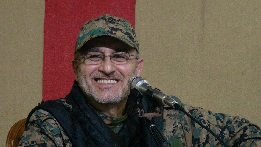 This undated handout image released on Friday, May 13, 2016, by Hezbollah Media Department, shows slain top military commander Mustafa Badreddine smiling during a meeting. Lebanon's militant Hezbollah group said its top military commander Mustafa Badreddine was killed in Syria. (Hezbollah Media Department via AP) MANDATORY CREDIT, NO SALES