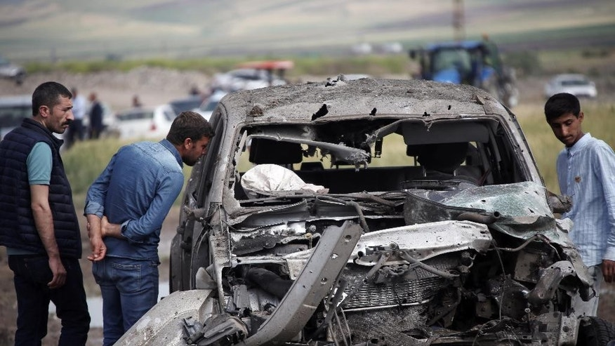 The destroyed car from an explosion in Sarikamis district outside Diyarbakir, Turkey Friday.