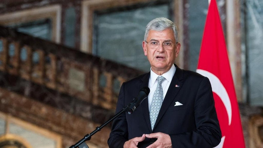 Turkey's EU Affairs Minister Volkan Bozkir addresses the media after a meeting with Belgium Foreign Minister Didier Reynders at the Egmont Palace in Brussels on Thursday May 12, 2016. (AP Photo/Geert Vanden Wijngaert)