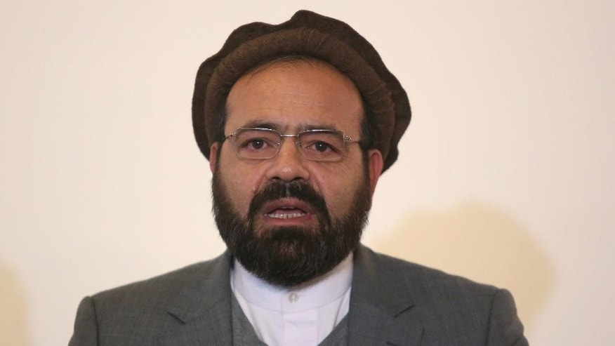 In this Thursday, March 17, 2016 photo, Amin Karim, an official of the Hezb-i-Islami Party, speaks during a press conference in Kabul, Afghanistan. An Afghan official says the government will finalize a peace deal with a notorious militant insurgent group within days. Ataullah Saleem, a deputy head of Kabul's High Peace Council, said on Saturday, May 14, an agreement with the armed wing of Hezb-i-Islami could be completed Sunday, after two years of negotiations. (AP Photo/Rahmat Gul)