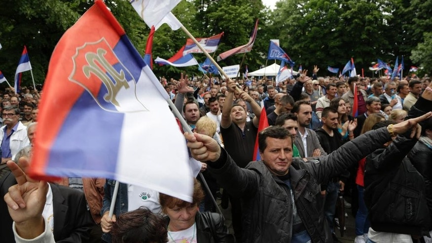Bosnian Serb people wave flags during a demonstration in Banja Luka, Bosnia, on Saturday, May 14, 2016. Tens of thousands of people are rallying in separate demonstrations for and against the regional Bosnian Serb government in the city Banja Luka. The pro-EU Alliance for Changes is accusing the Bosnian Serb government of corruption and its leader Milorad Dodik of dictatorship, saying he has brought the region to the brink of financial collapse. Dodik's camp is accusing the opposition of betraying Bosnian Serb national interests. (AP Photo/Amel Emric)