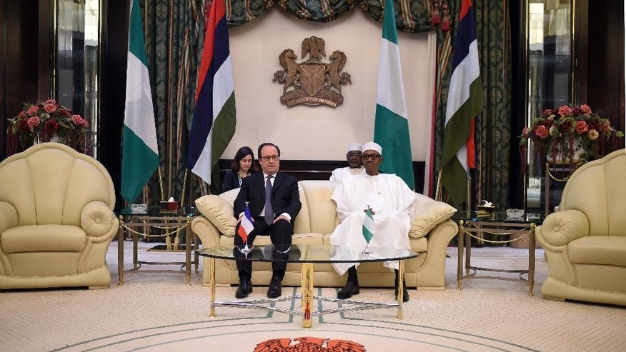French President Francois Hollande, left, speaks poses with Nigerian President Muhammadu Buhari during a meeting in Abuja, Nigeria, Saturday, May 14, 2016. Hollande is on one day visit to Nigeria to attend a regional security summit. (Stephane De Sakutin/Pool Photo via AP)