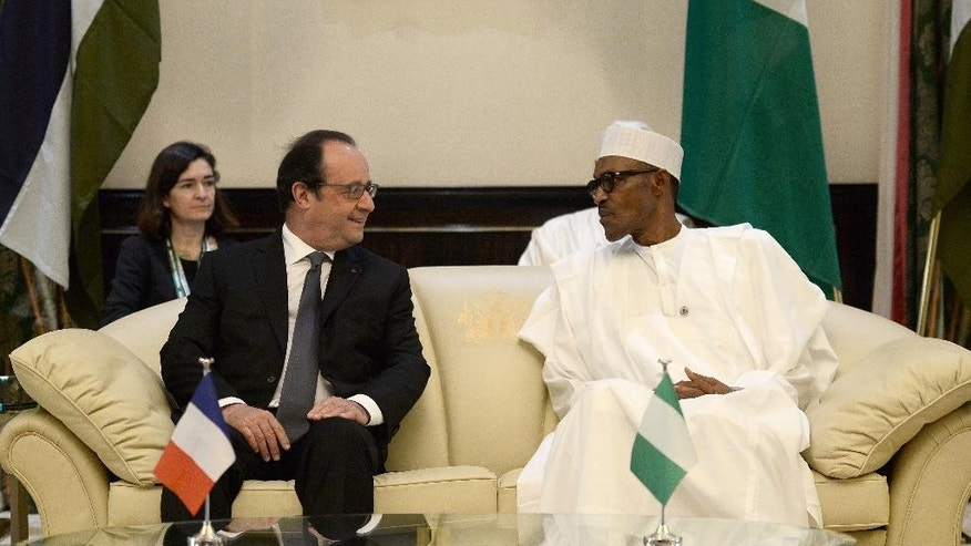 French President Francois Hollande, left, speaks with Nigerian President Muhammadu Buhari during a meeting in Abuja, Nigeria, Saturday, May 14, 2016. Hollande is on one day visit to Nigeria to attend a regional security summit. (Stephane De Sakutin/Pool Photo via AP)